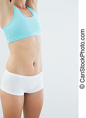 Mid section of a fit young woman in