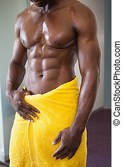 Mid section of a shirtless muscular man - Close-up mid...