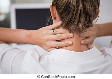 Mid section of businesswoman suffering from neck ache -...