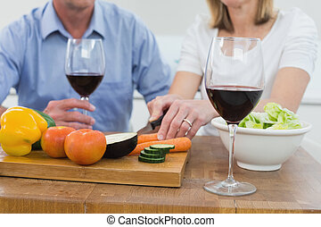 Mid section of couple with wine gla - Close-up mid section ...