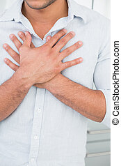Mid section of man with chest pain