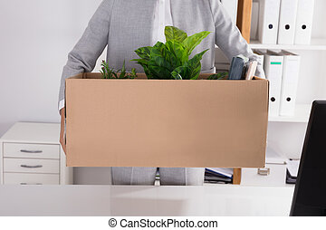 Businessperson Carrying Cardboard Box With Belongings