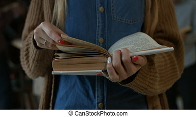 Midcsection of female student reading a book