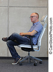 man sitting  on office arm chair