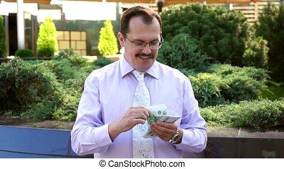 Middle age businessman counts euro cash