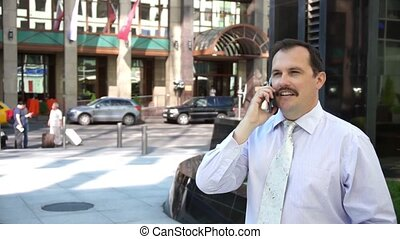 Middle age businessman speaking using smartphone in modern...