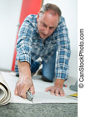 middle-age carpet fitter