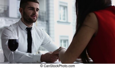 Middle age couple at the restaurant. couple interacting at lunch in a fancy restaurant