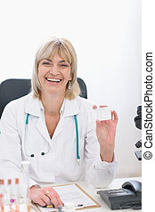 Middle age doctor woman showing business card