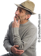 middle age man adventure hat thinking