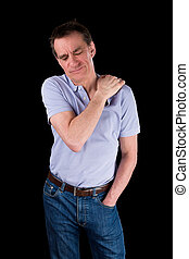 Middle Age Man Holding Shoulder in Pain