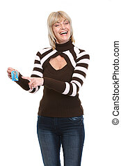 Middle age realtor woman pointing on keys