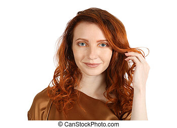 Middle age red-haired woman smiles at the camera over white