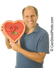 middle age senior man  box of Valentine day chocolate candy