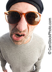 middle age senior man  grumpy funny face twisted mouth wearing artist french hippie beret hat macro close up distorted large nose face