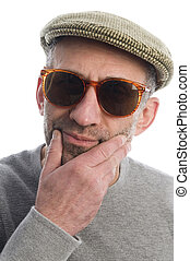 middle age senior man wearing artist scottish tweed  hat macro close up distorted large nose face retro sunglasses expression