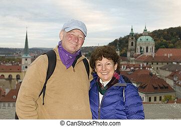 middle age senior smiling man woman tourist couple Castle District Prague Czech Republic