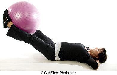 middle age senior woman exercise with core training ball