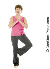 middle age senior woman fitness yoga pose