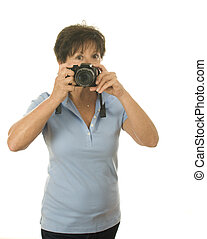 middle age senior woman with camera taking photo