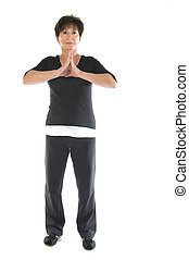 middle age senior woman yoga position stretch