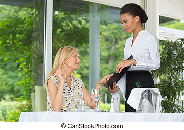 middle-age woman choosing food in restaurant