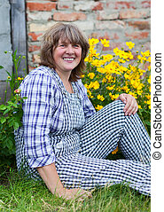 Middle age woman on the farm - Middle age woman in working...