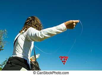 Middle Age Woman playing with a Tetrahedral Strange Kite