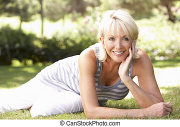 Middle age woman posing in park