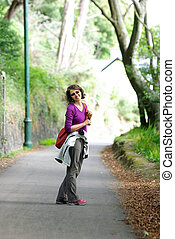 middle age woman smiling during walking