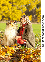 Middle age woman with collie dog
