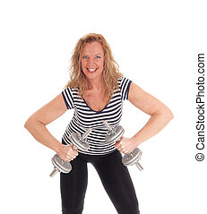 Middle age woman workout with dumbbells.