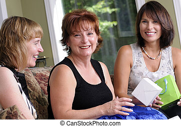 Middle Age Women - Three Woman Giving A Surprise Gift To ...