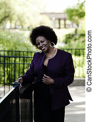 Middle Aged African American Woman Outdoors Park Smiling