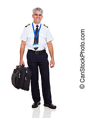 middle aged airline pilot carrying briefcase