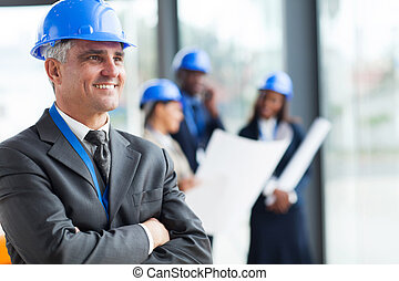 middle aged architect with arms folded