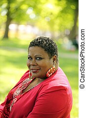 Middle Aged Black Woman Park Red Jacket