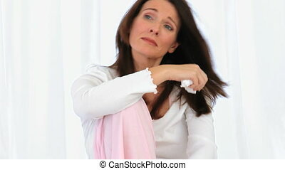 Middle aged brunette crying isolated on a white background