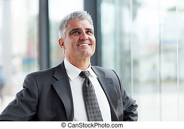 middle aged businessman looking up