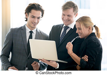 Middle aged businessman showing progress to his team