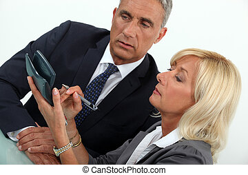 middle aged businessman with female counterpart