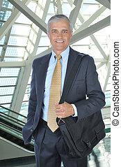 Middle aged Businessman with Shoulder Bag