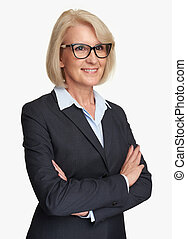 Middle aged businesswoman wearing glasses. Isolated