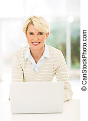 middle aged businesswoman with laptop