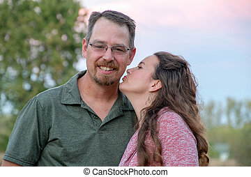 woman kissing man on cheek