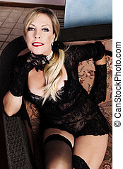 Middle-Aged Caucasian Woman Sitting In Black Lacy Lingerie