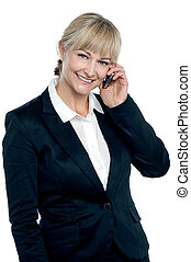 Middle aged corporate woman talking on mobile