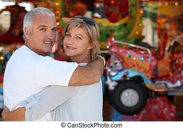 Middle-aged couple at funfair