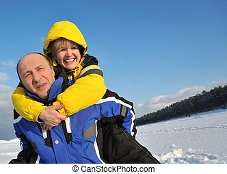 Middle aged couple having fun on a winter day