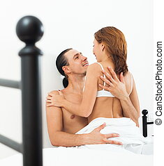 Middle-aged couple in bed